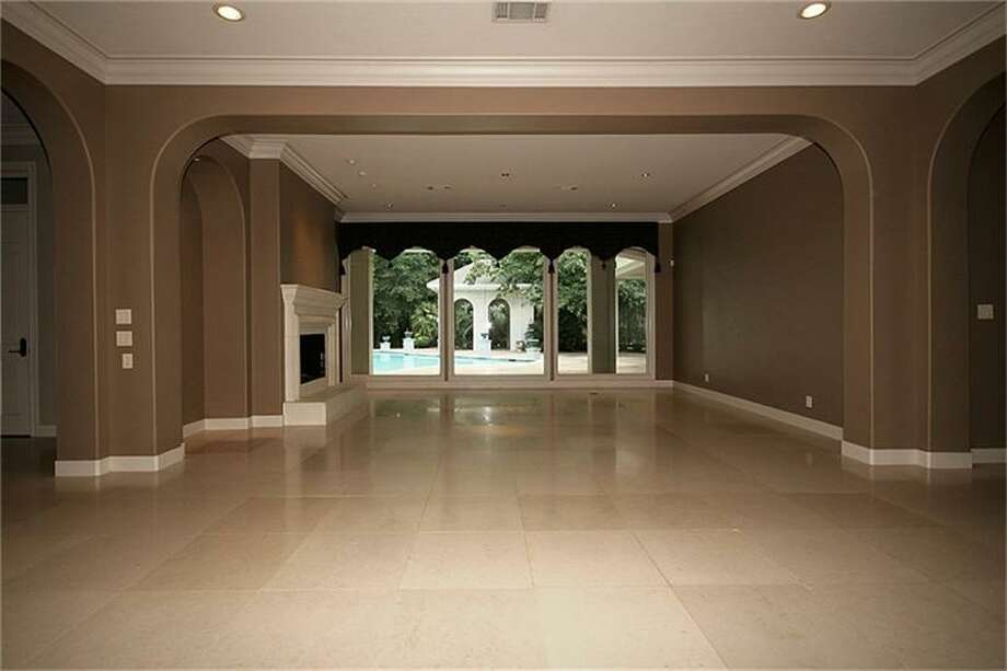 The home offers an open floor plan with custom tile flooring.