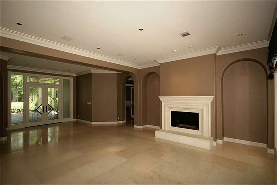 The family area has tile flooring and a fireplace.