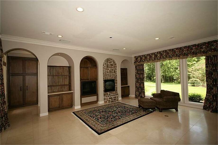 Built-in shelving, large windows and a fireplace are some of the home's many features.