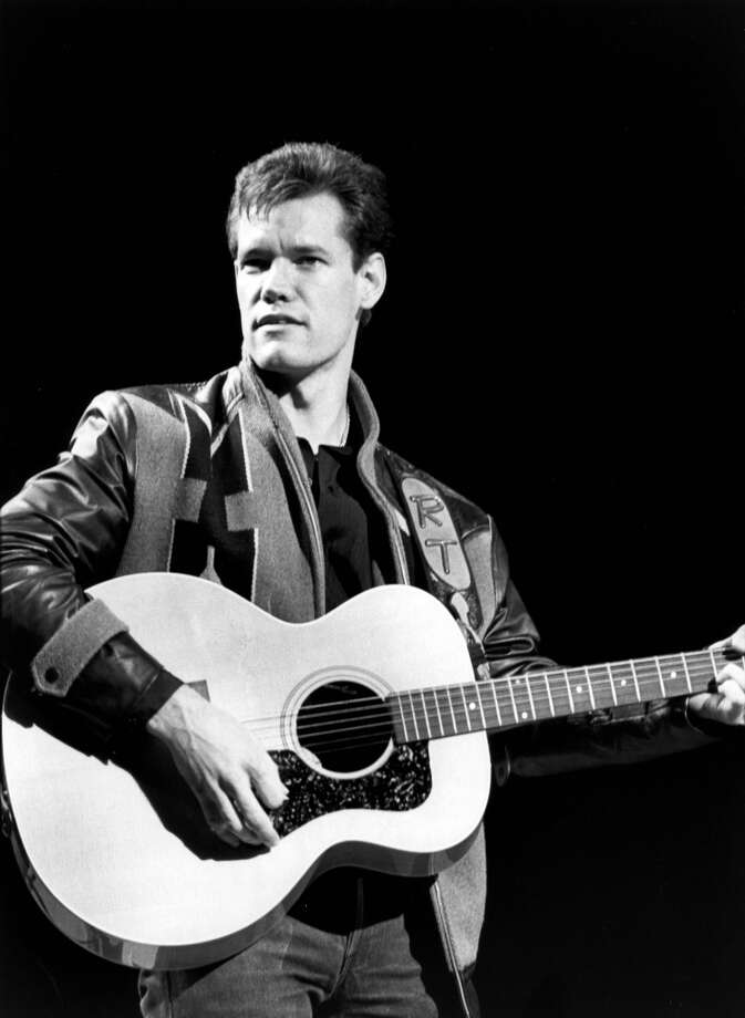 Photo of Randy TRAVIS; performing live on stage  (Photo by Ebet Roberts/Redferns)