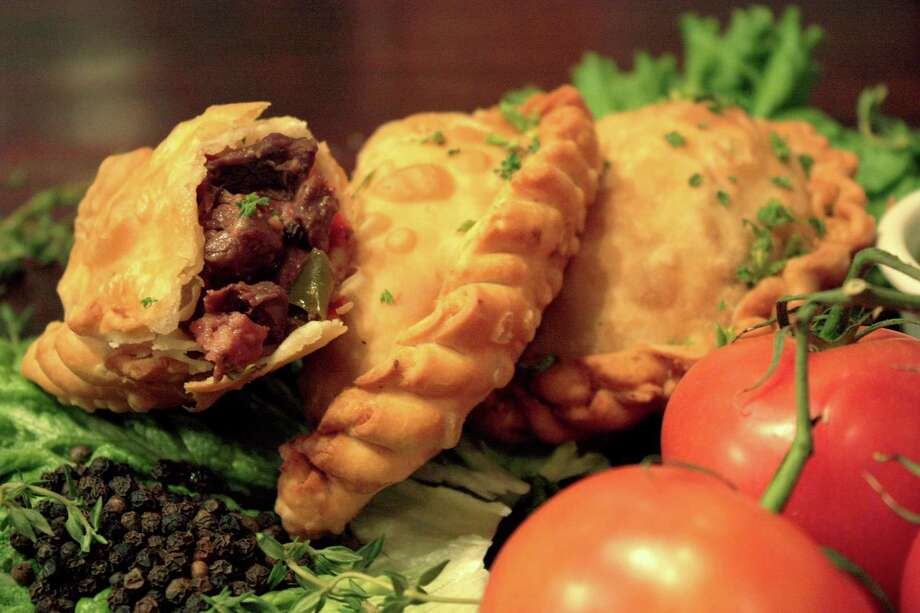 The menu at Tierra del Fuego includes empanadas.