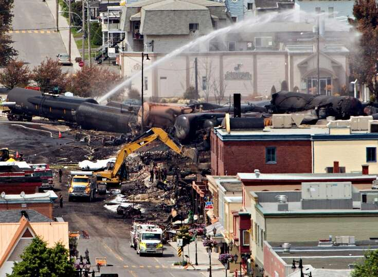 Searchers dig through the rubble for victims of the inferno in Lac-Megantic, Quebec, Monday, July 8,