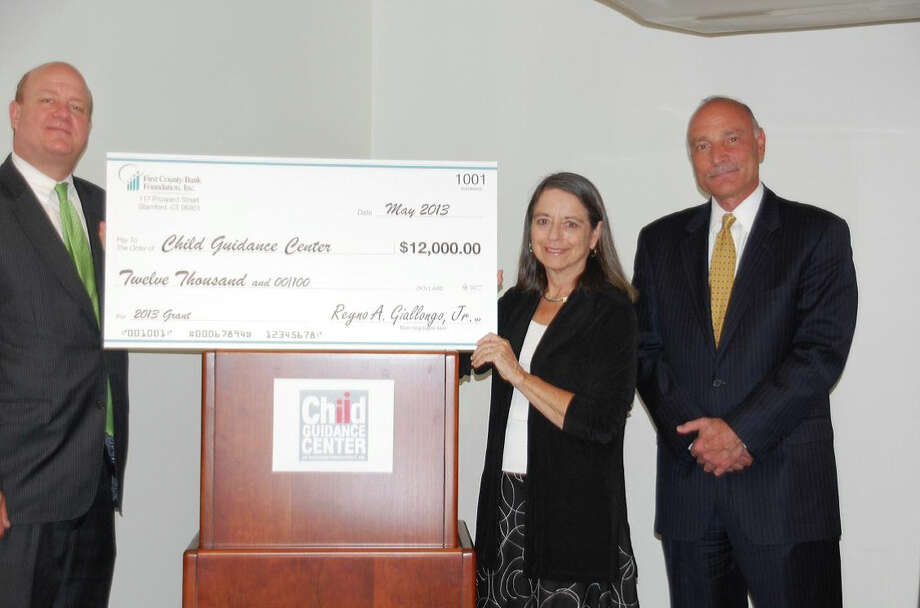 The First County Bank Foundation recently gave a $12,000 grant to the Child Guidance Center of Southern Connecticut to support emergency mobile psychiatric services in New Canaan and other communities. From left, Mark Rosenbloom, assistant vice president at First County Bank; Sherry Perlstein, president and CEO, Child Guidance Center; and Richard Zaremski, senior vice president First County Bank. Photo: Contributed