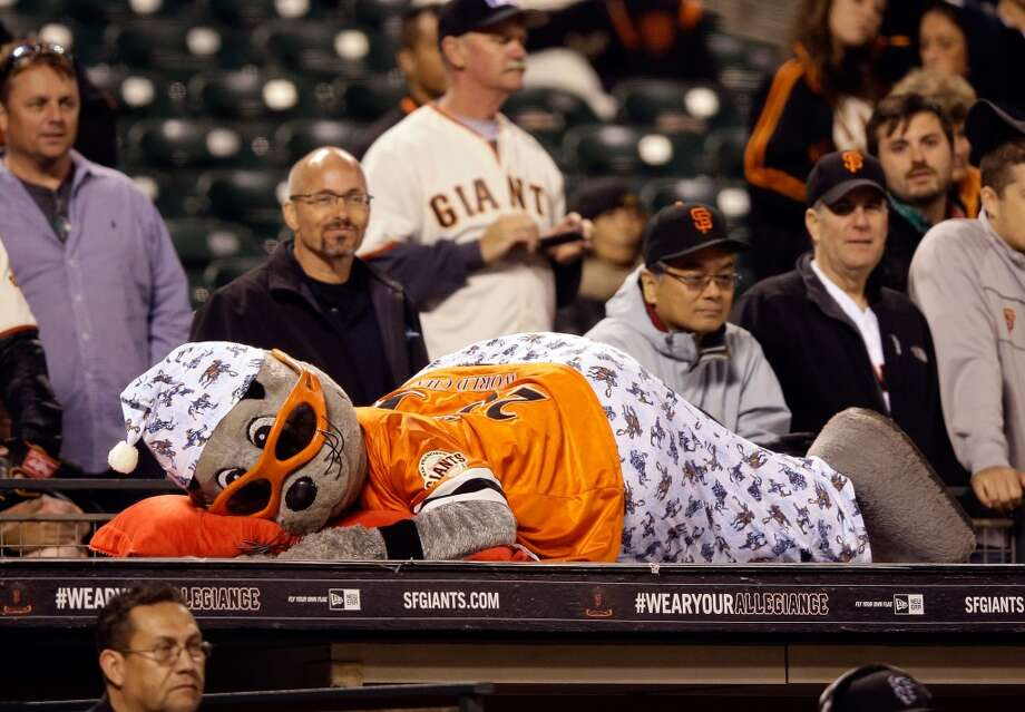San Francisco Giants mascot Lou Seal watches the game in pajamas in the 15th inning against the New York Mets at AT&T Park on July 8, 2013 in San Francisco, California.