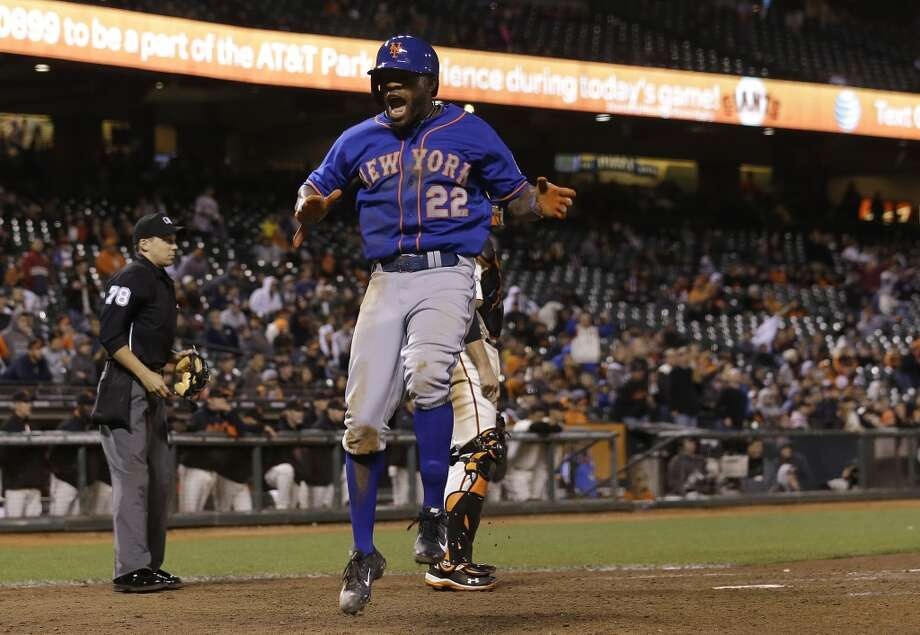 New York Mets' Eric Young Jr. (22) celebrates after scoring against the San Francisco Giants during the 16th inning of a baseball game in San Francisco, Tuesday, July 9, 2013.