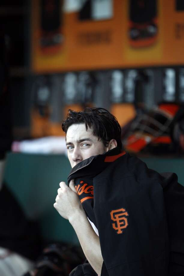 Tim Lincecum sits in the dugout in the first inning, and would pitch seven innings striking out eleven. The San Francisco Giants played the New York Mets at AT&T Park in San Francisco, Calif., on Monday, July 8, 2013.