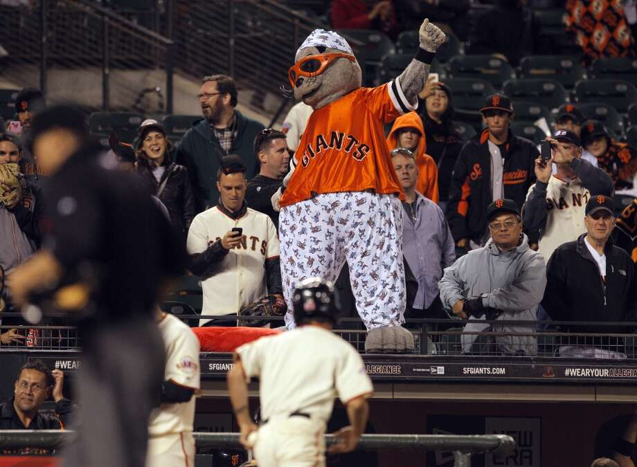Lou Seal pantomimes yawning while wearing pajamas as the clock struck midnight in the fifthteenth inning. The San Francisco Giants played the New York Mets at AT&T Park in San Francisco, Calif., on Monday, July 8, 2013, losing 4-3 in 16 innings.
