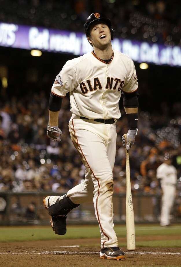 San Francisco Giants' Buster Posey reacts after striking out during the thirteenth inning of a baseball game against the New York Mets in San Francisco, Monday, July 8, 2013. The Mets won 4-3 in 16 innings.