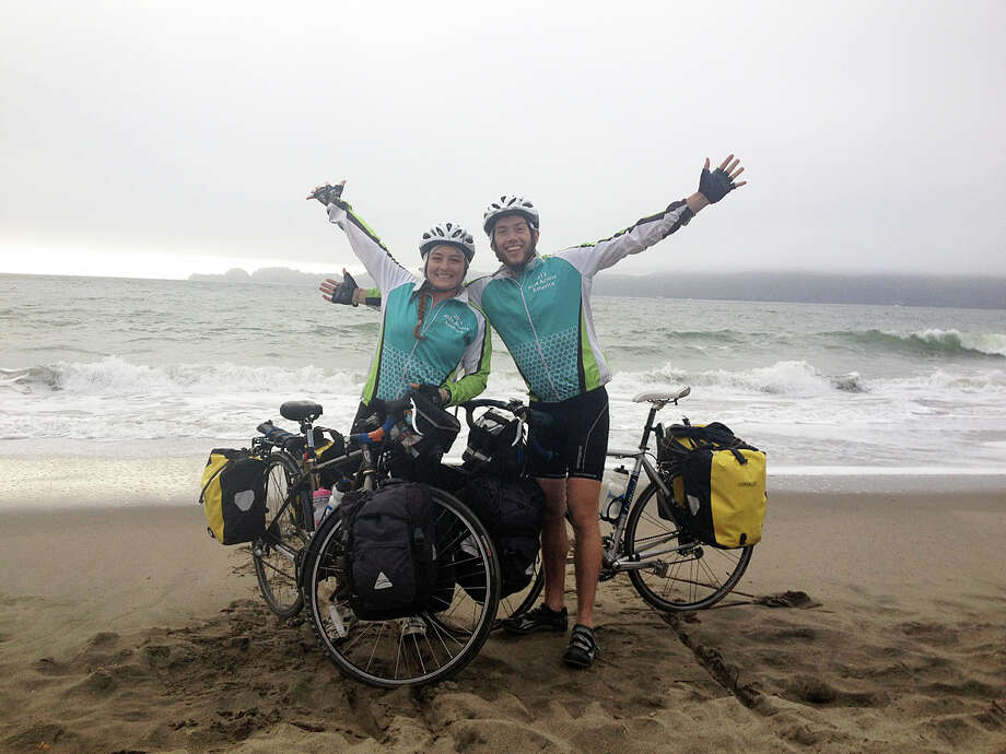 Allie Wills and Alec Bernard reach the Pacific Ocean after a crosscountry bike trip that began in Westport. Photo: Contributed Photo / Westport News