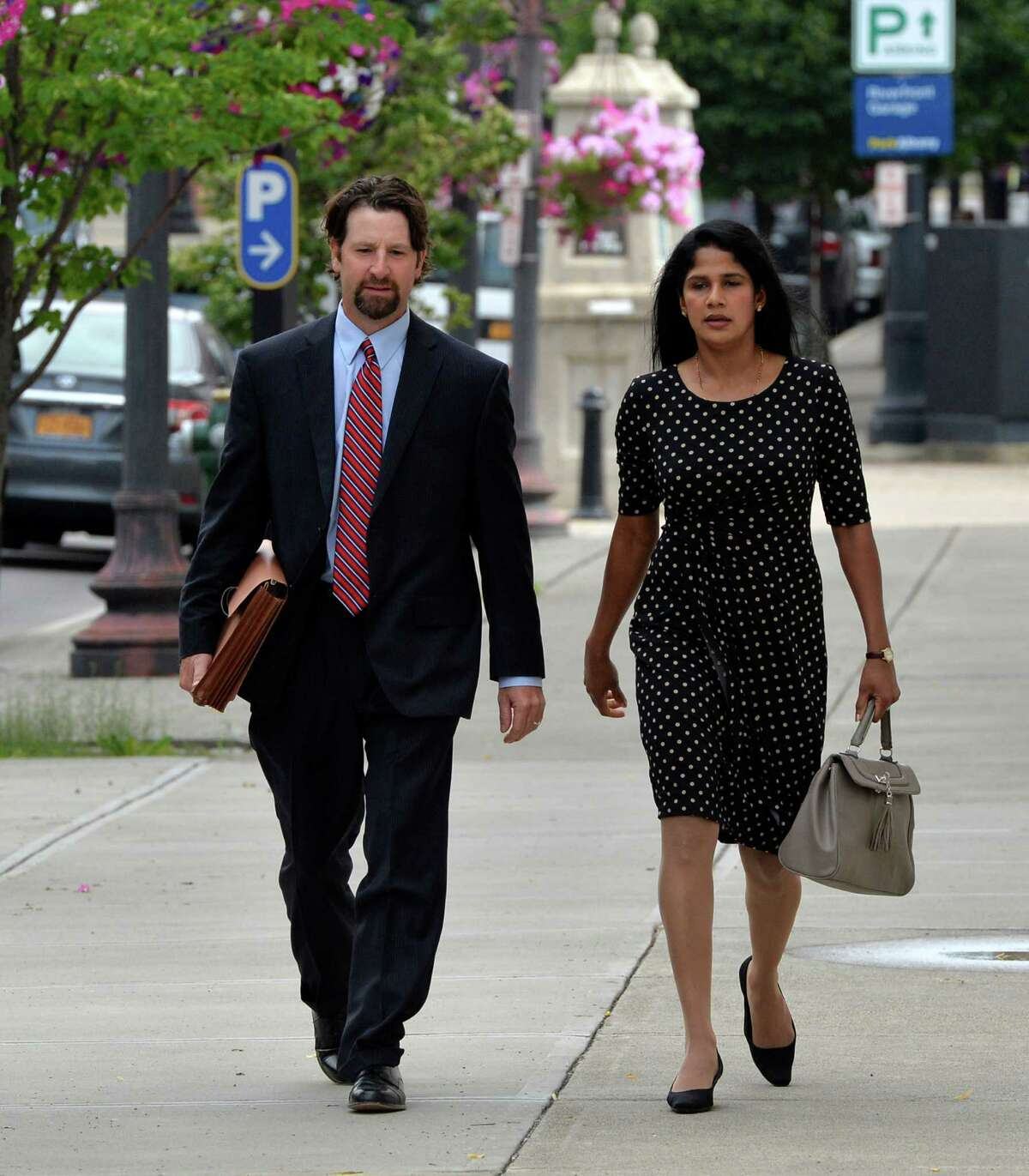 Annie George, right, arrives for her sentencing at the Federal Courthouse with her attorney Mark Sacco, left, Monday morning, July 9, 2013, in Albany, N.Y. (Skip Dickstein/Times Union)