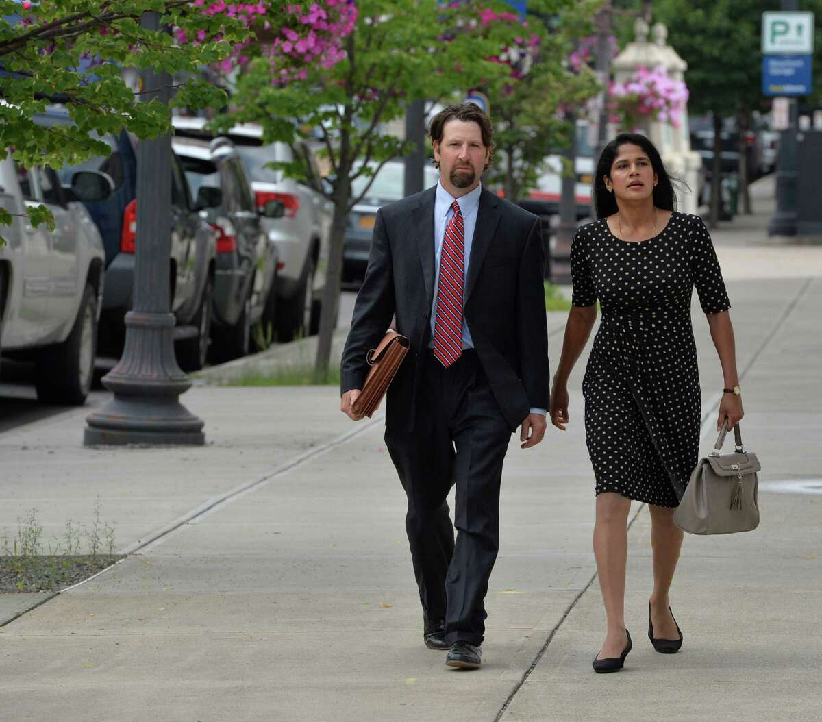 Annie George arrives for her sentencing at the Federal Courthouse with her attorney Mark Sacco July 9, 2013 in Albany, N.Y. (Skip Dickstein/Times Union)