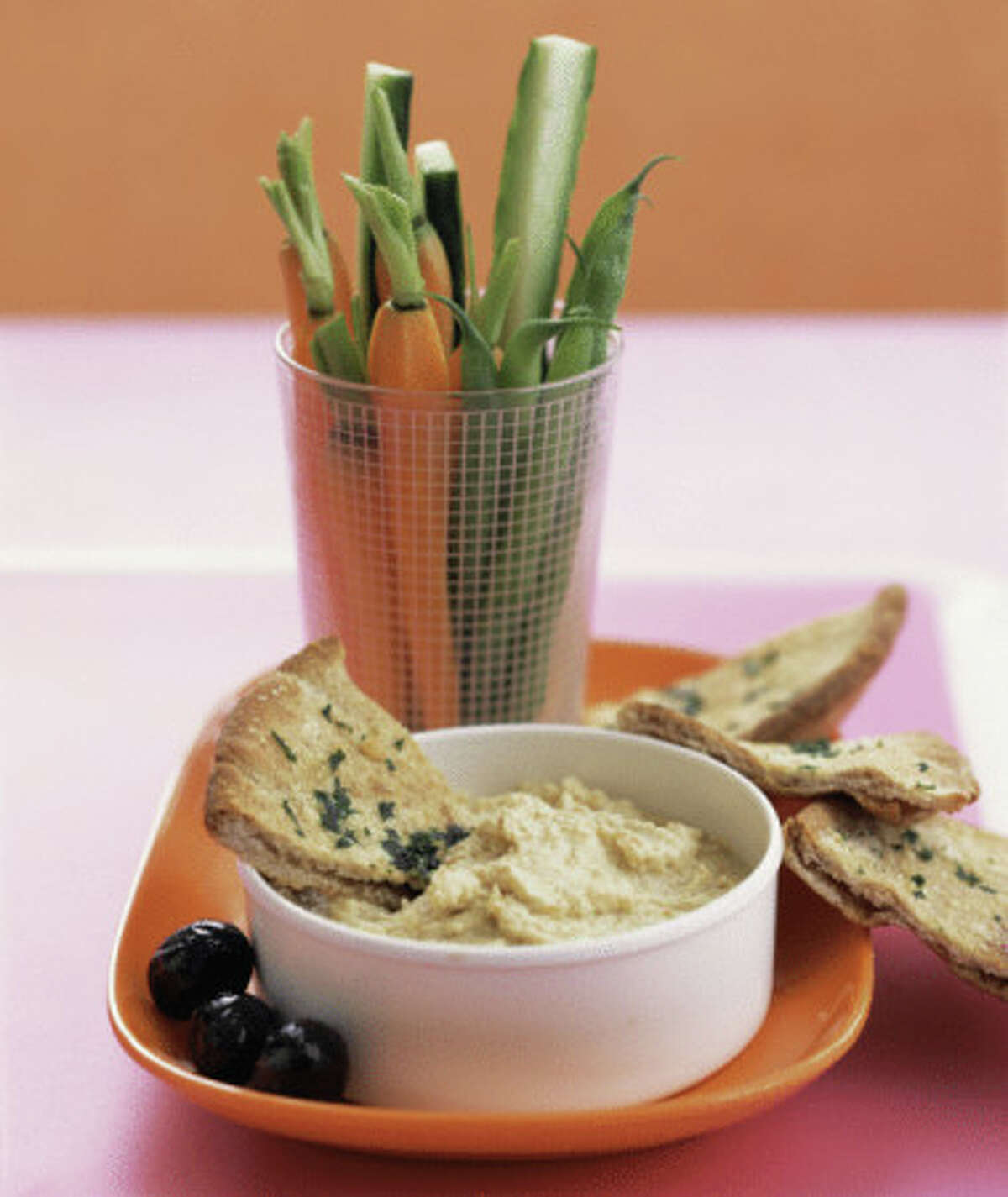 Hummus has protein, is easy to travel with and is a great snack.