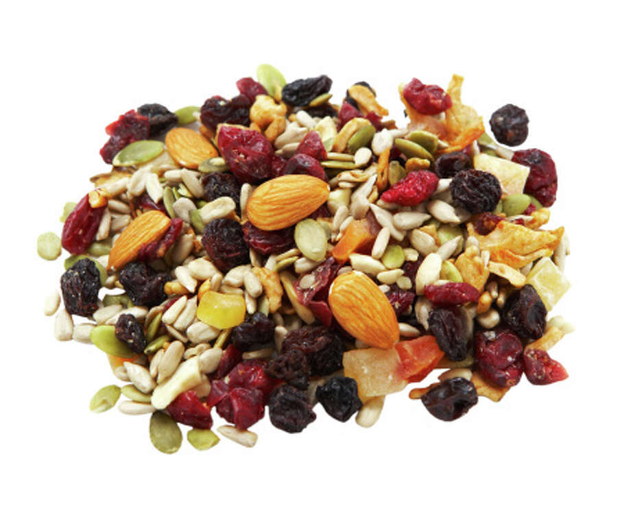 Trail mix is a great combo of fruits and nuts, which will satisfy hunger and give you protein. Photo: Thomas Northcut, Getty Images / (c) Thomas Northcut