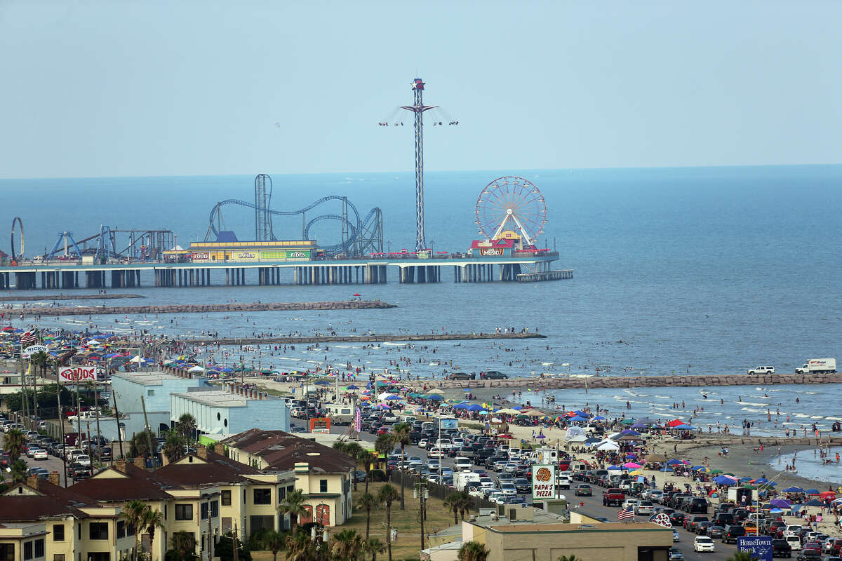 The Historic Pleasure Pier amusement park, Seawall Boulevard and beaches of Galveston Island, Texas, are seen from atop the San Luis Resort on Thursday, July 4, 2013. The Historic Pleasure Pier amusment park, seawall, and beaches of Galveston Island, Texas are seen from atop the San Luis Resort on Thursday, July 4, 2013. (AP Photo/Dr. Scott M. Lieberman) STAND ALONE