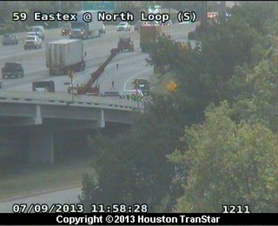 Traffic was snalred on the southbound Eastex Freeway after a big-rig lost its cargo on the ramp to the North Loop late Tuesday morning. Photo: Houston Transtar