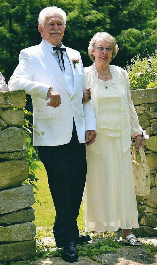 Tom and Joyce Ward of New Milford are shown celebrating their 60th wedding anniversary in June 2013. Photo: Contributed Photo