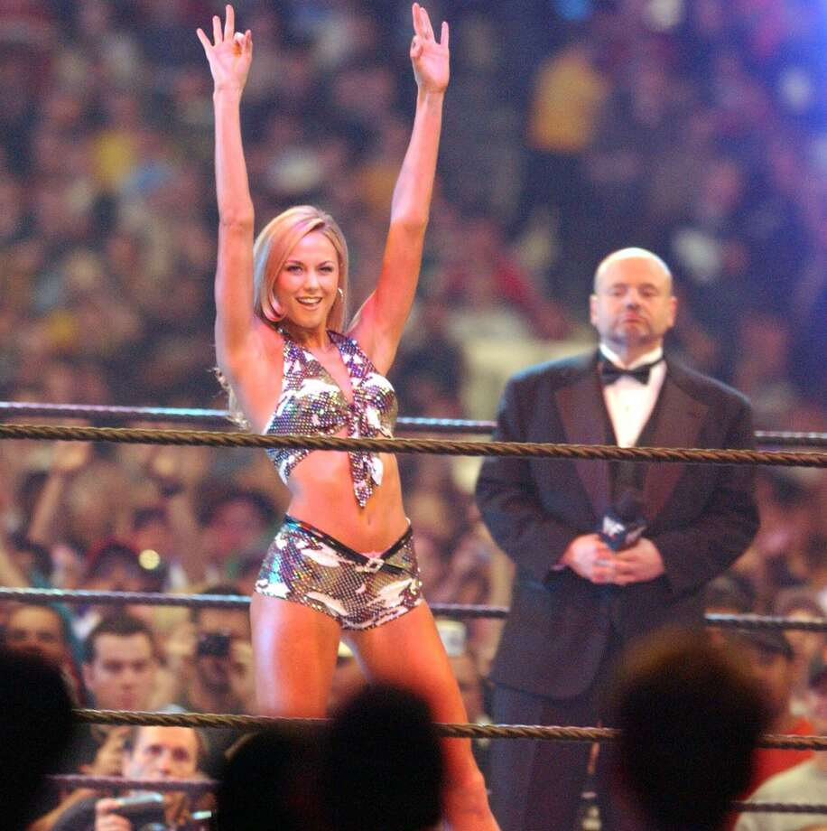 What Stacy Keibler was doing before she met George Clooney. (At  Wrestlemania X8, 2002).