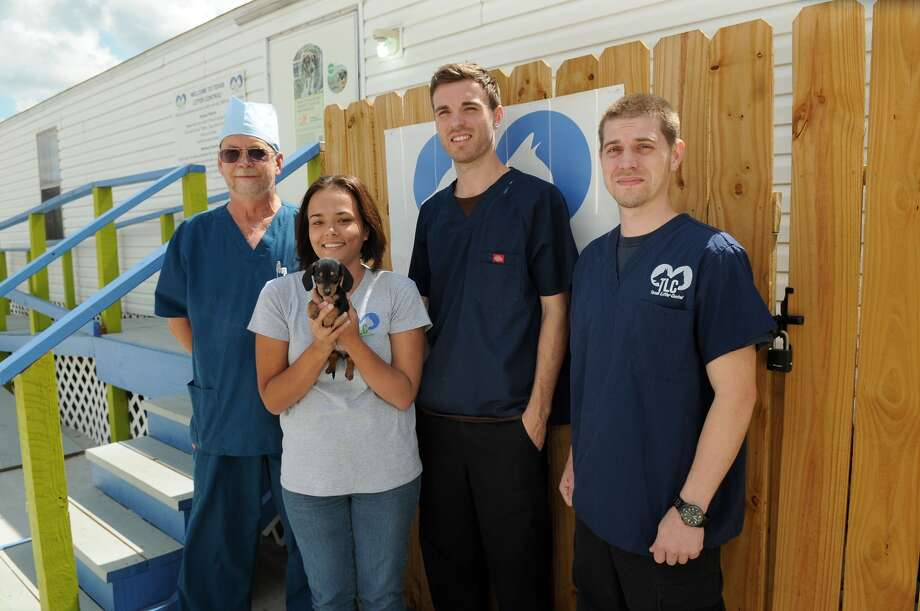 The surgical staff at Texas Litter Control, including Dr. Dave Rundell, from left, Vanessa Castillo, Zach Sebree, and Larry Sellens, pose for a photo in front of the TLC surgical center. Freelance photo by Jerry Baker Photo: Jerry Baker, Freelance