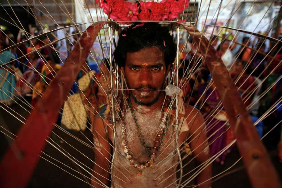 San Antonio has steadily increased its global presence through the years. And the growth of the Alamo City's global ambitions has sparked relationships with other cities. Here are the current Sister Cities around the world. Chennai: A Hindu devotee, body pierced with skewers, participates in a religious procession during Panguni Uthiram festival in Chennai, India, Tuesday, March 26, 2013. Photo: Associated Press