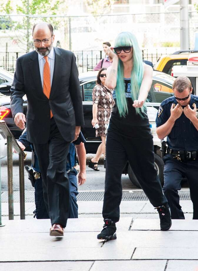 NEW YORK, NY - JULY 09:  Amanda Bynes arrives for  an appearance at Manhattan Criminal Court on July 9, 2013 in New York City. Bynes is facing charges of reckless endangerment, tampering with evidence and criminal possession of marijuana in relation to her arrest on May 23, 2013.  (Photo by Dave Kotinsky/Getty Images)