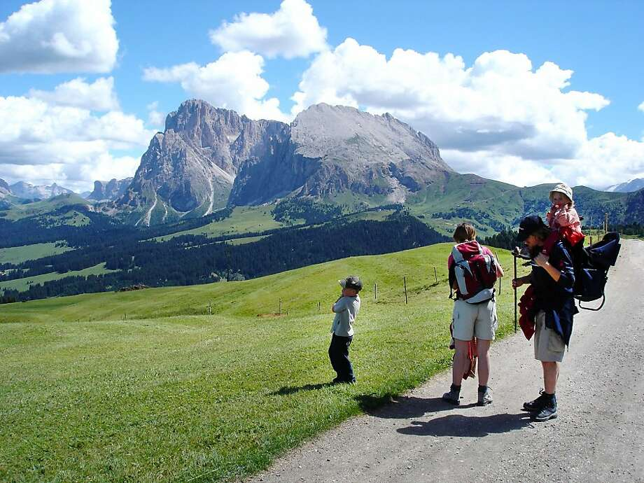 A family gets ready for a hike in Italy's Alpe di Siusi, the largest alpine meadow in Europe. Photo: Rick Steves, Rick Steves' Europe