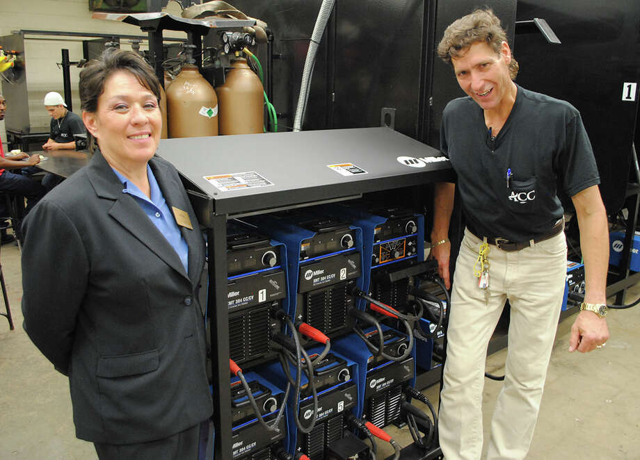 Alvin Community College welding instructor Laura Bell and instructor Joe Socias are excited about new equipment available to their students in the expanded classroom facility.