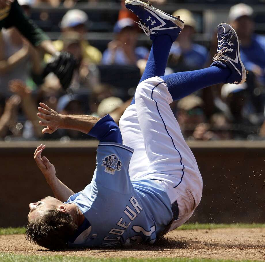 Kansas City Royals' Jeff Francoeur rolls after he was called out at home on a double play hit into by Alcides Escobar during the sixth inning of a baseball game against the Oakland Athletics, Saturday, June 2, 2012, in Kansas City, Mo.