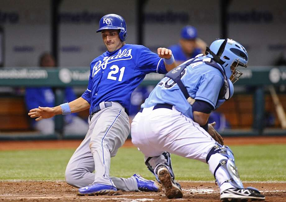 Kansas City Royals' Jeff Francoeur, left, scores in front of Tampa Bay Rays catcher Jose Molina off of Alex Gordon's one-run single during the sixth inning of a baseball game Sunday, June 16, 2013, in St. Petersburg, Fla.