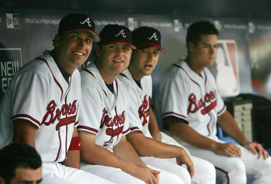 Atlanta Braves rookies from left; Jeff Francoeur, Brian McCann, Kyle Davies and Kelly Johnson sit in the dugout during the Braves' game in this July 7, 2005 photo.
