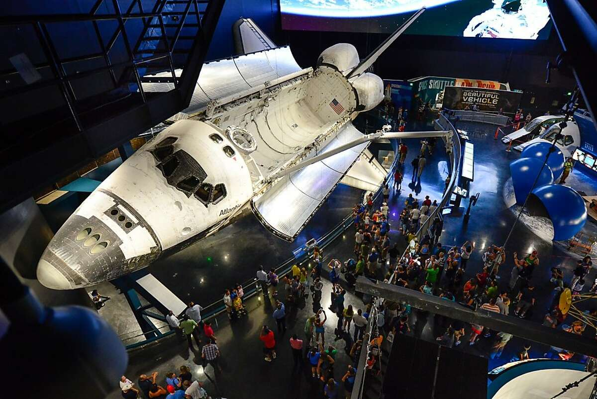 Space shuttle Atlantis, seen here in space, is now the centerpiece of the new 90,000-square-foot attraction at the Kennedy Space Center Complex in Florida.