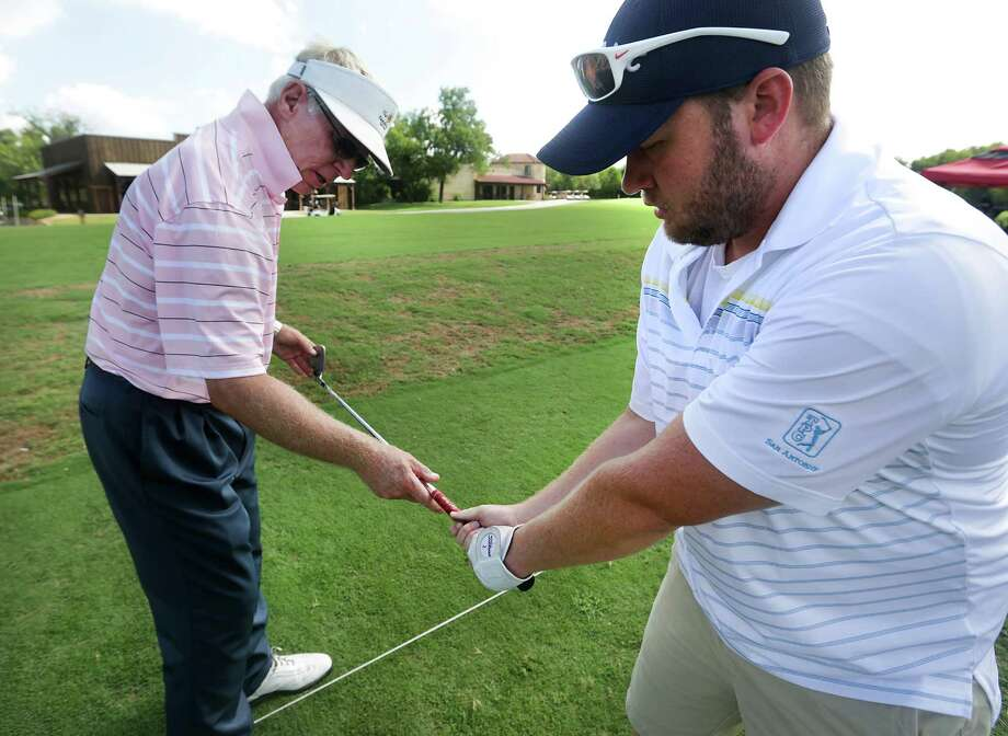Tom Olson, left, Director of Foresight Golf's Play Better Golf, helps Andrew Eubanks with his golf swing at The Republic Golf Course, on Tuesday, July 9, 2013. Photo: Bob Owen, San Antonio Express-News / © 2012 San Antonio Express-News