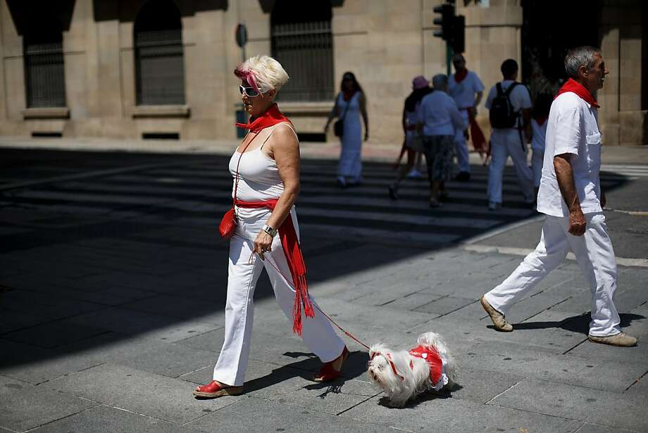 Before the running of the bulls comes the walking of the Shih Tzus: These days, even your grandmother can run with the bulls of Pamplona. Photo: Pablo Blazquez Dominguez, Getty Images