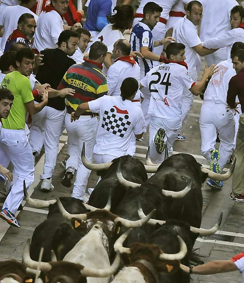 I got dibs on 24: Valdefresno ranch fighting bulls chase revelers during the San Fermin fiestas in Pamplona, Spain. Photo: Alvaro Barrientos, Associated Press