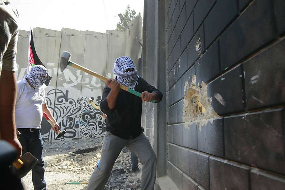 This may take longer than we thought:Palestinians try to demolished a section of the 