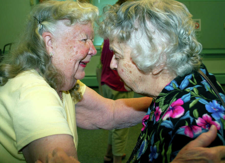 Dotty Cooper, left, and Pat Vontobel share a warm greeting before starting the hula lessons class at the New Milford Senior Center. For Maturity, July 2013. Photo: Deborah Rose