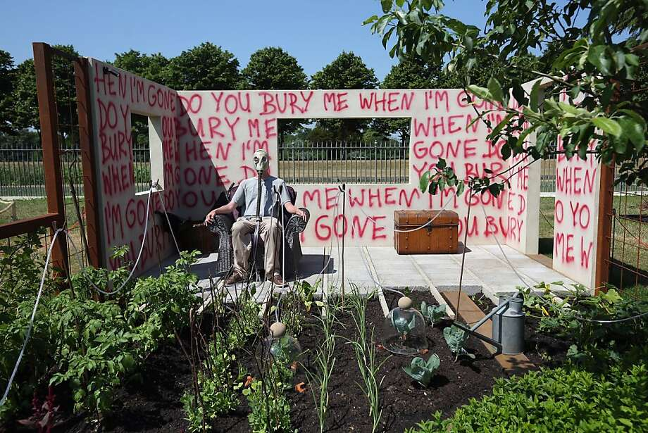 "Doom and bloom:The ominous ""I Disappear"" garden, complete with man in gas mask, is one of the many horticultural displays at the Hampton Court Palace Flower Show in London, the largest flower show in the world. Photo: Oli Scarff, Getty Images"