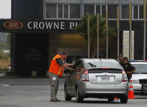 Security personnel limit access to the Crowne Plaza Hotel in Burlingame, Calif. on Tuesday, July 9, 2013, where the parents of passengers from Asiana Airlines flight 214 are reportedly staying. Photo: Paul Chinn, The Chronicle