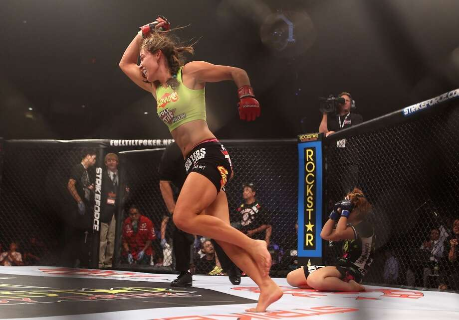 Miesha Tate celebrates after defeating Hitomi Akano of Japan in the Strikeforce Women's Welterweight Tournament Championship bout at Dodge Theater on Aug. 13, 2010, in Phoenix.