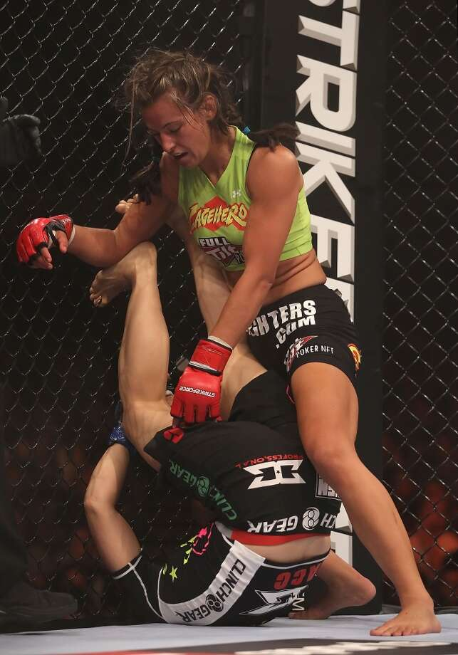 Miesha Tate knocks down Hitomi Akano of Japan in the Strikeforce Women's Welterweight Tournament Championship bout at Dodge Theater on Aug. 13, 2010, in Phoenix.
