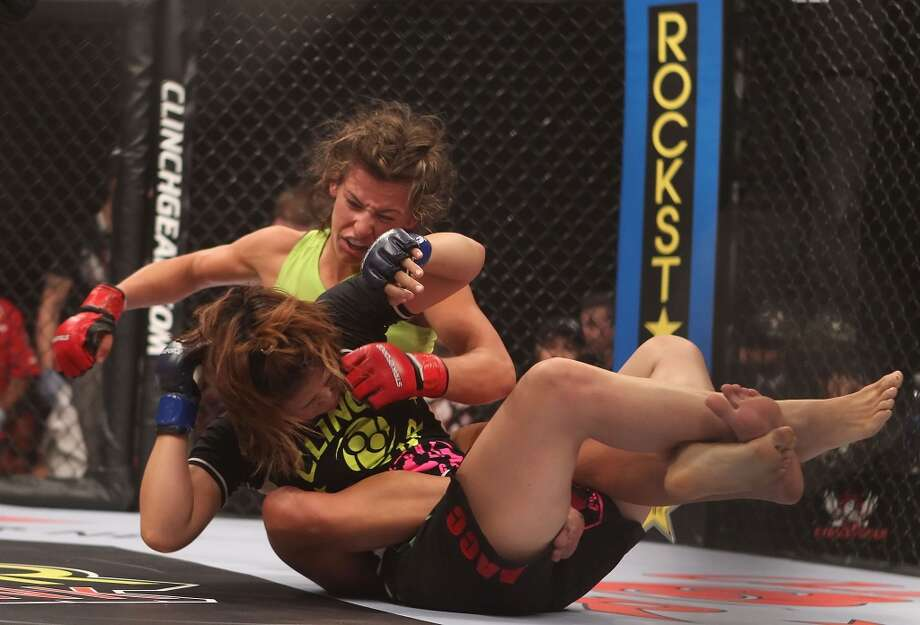 Miesha Tate, left, battles with Hitomi Akano of Japan in the Strikeforce Women's Welterweight Tournament Championship bout at Dodge Theater on Aug. 13, 2010, in Phoenix.