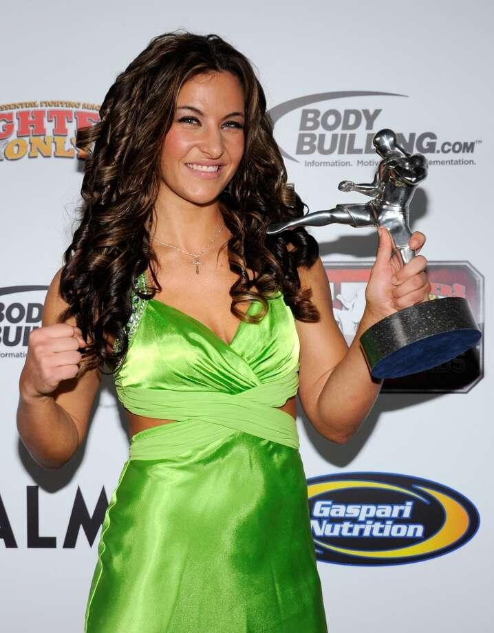 Mixed martial artist Miesha Tate holds the Female Fighter of the Year award at the Fighters Only World Mixed Martial Arts Awards 2011 at The Pearl concert theater at the Palms Casino Resort Nov. 30, 2011, in Las Vegas.