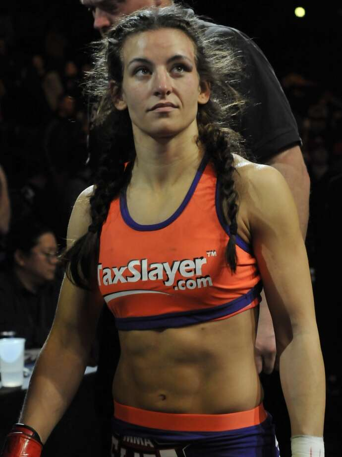Miesha Tate walks back to the dressing room after her fight at the the Strikeforce event at Nationwide Arena on March 3, 2012, in Columbus, Ohio.