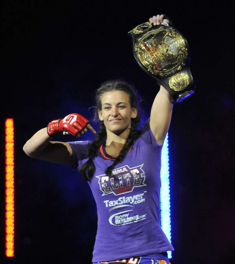 Miesha Tate walks to the cage before her bantamweight bout during the Strikeforce event at Nationwide Arena on March 3, 2012, in Columbus, Ohio.