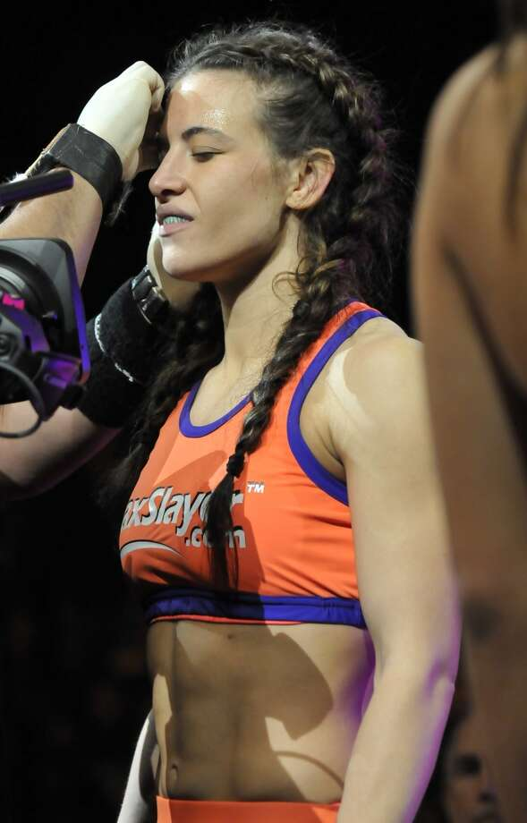 Miesha Tate prepares to enter the cage before her bantamweight bout during the Strikeforce event at Nationwide Arena on March 3, 2012, in Columbus, Ohio.
