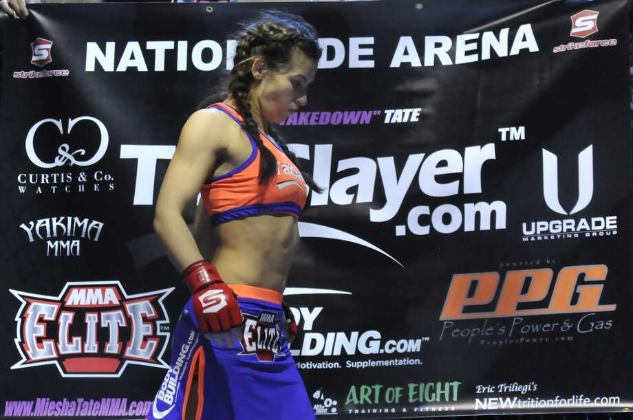 Miesha Tate paces around in the cage before her bantamweight bout during the Strikeforce event at Nationwide Arena on March 3, 2012, in Columbus, Ohio.