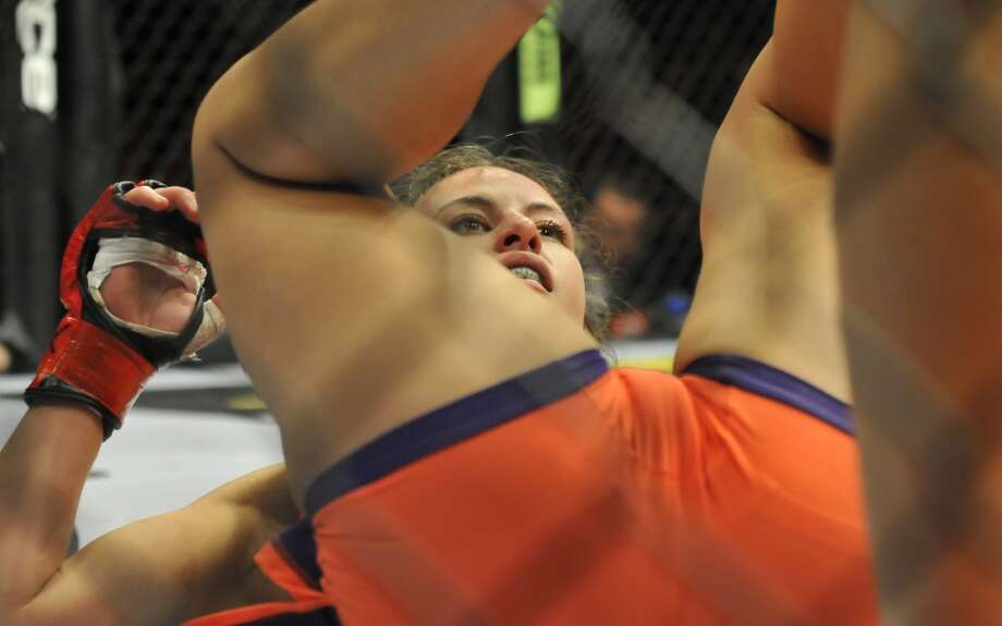 Miesha Tate lays on her back looking for a move to make during a bantamweight bout at the the Strikeforce event at Nationwide Arena on March 3, 2012, in Columbus, Ohio.