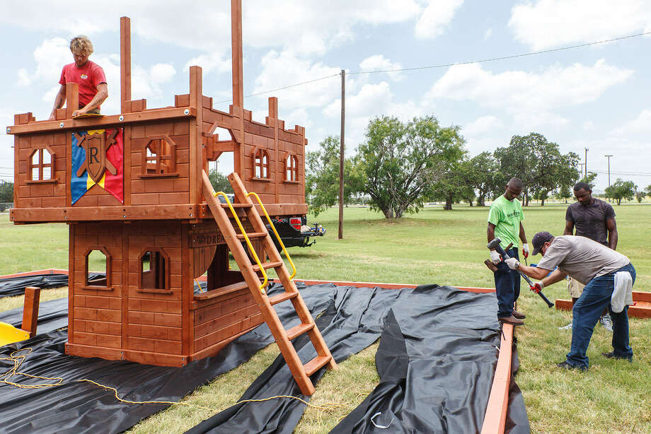 Steve Ramirez (front right), Darnell Williams (top right) and Walter Reese of Grande Communications and James Ortez (left) with Rainbown Play Systems, Inc. help to build the new playground on the Boys Town Texas campus at 8410 Flanagan Street. Photo: Marvin Pfeiffer / Northwest Weekly