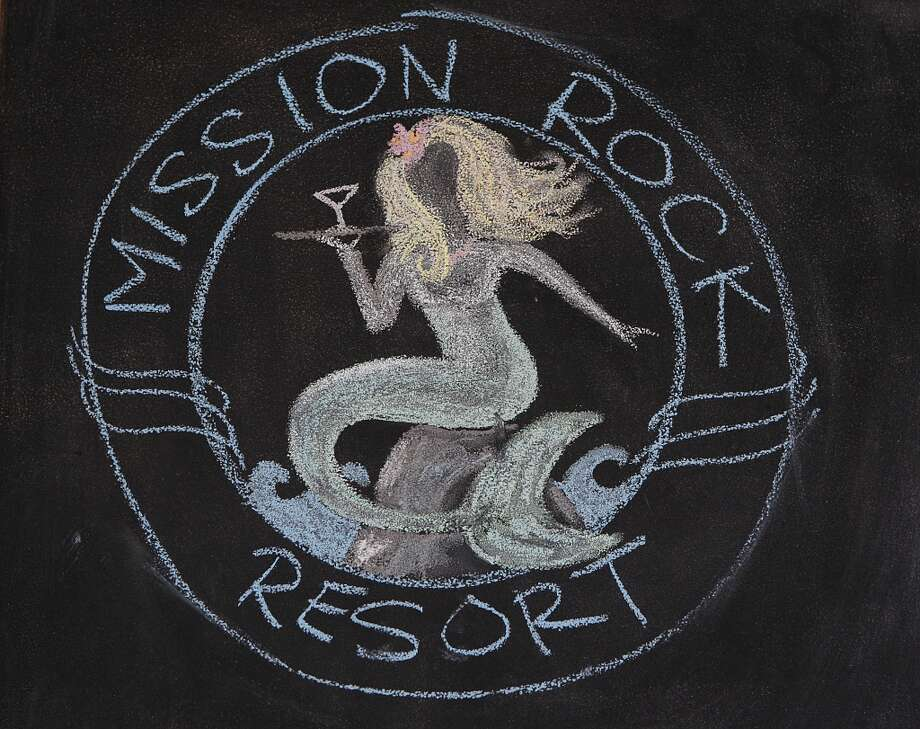 The logo for Mission Rock Resort on their chalk board.