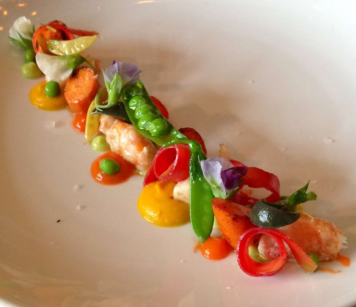 Spot prawns, roasted carrots, snap peas, English peas, pea blossoms and flash pickled black carrots at Uchi Houston.