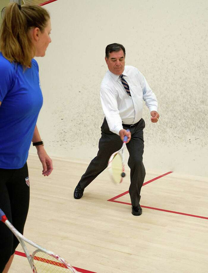 Stamford Mayor Michael Pavia plays squash with U.S. National Champion Natalie Grainger at Chelsea Piers Connecticut on Tuesday, July 9, 2013. Pavia took a tour of the facility as part of their one year anniversary celebration. Photo: Lindsay Perry / Stamford Advocate